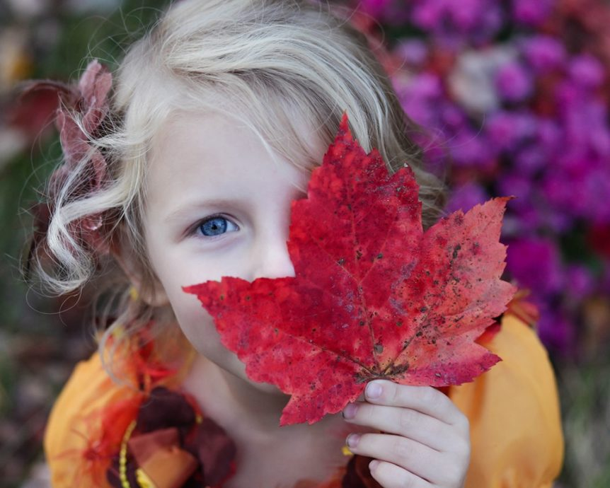 Girl holding maple leaf