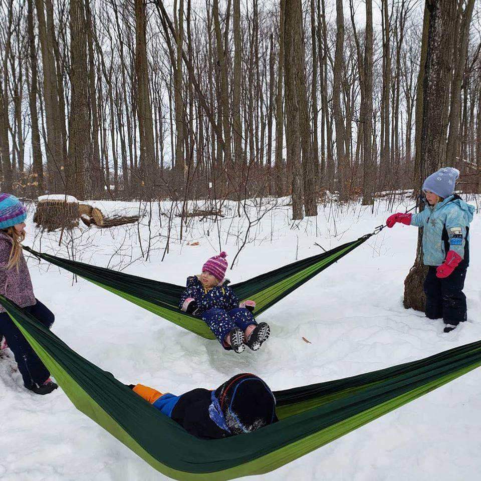 Children playing in hammocks